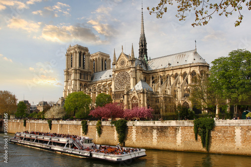 Paris, Notre Dame cathedral with boat on Seine