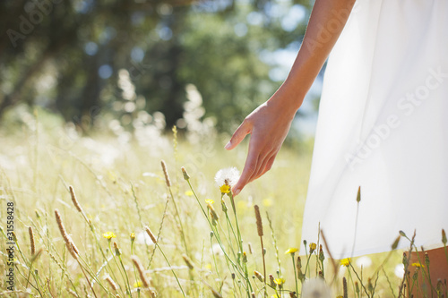 Woman walking through field
