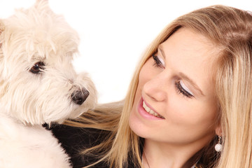 Attractive happy young woman with dog