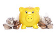 Yellow piggybank with sterling money