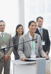Businesswoman speaking at podium