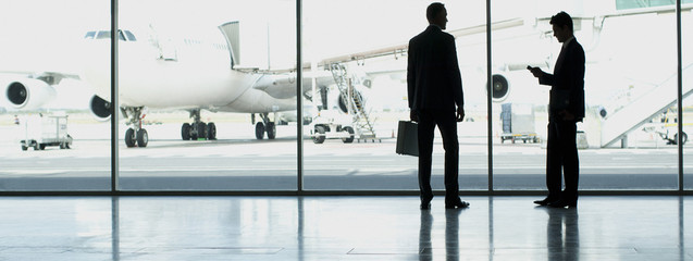 Businessmen standing in airport