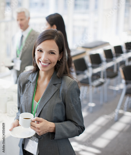Businesswoman drinking coffee in office