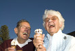 Elderly couple laughing at ice cream accident - 31564818