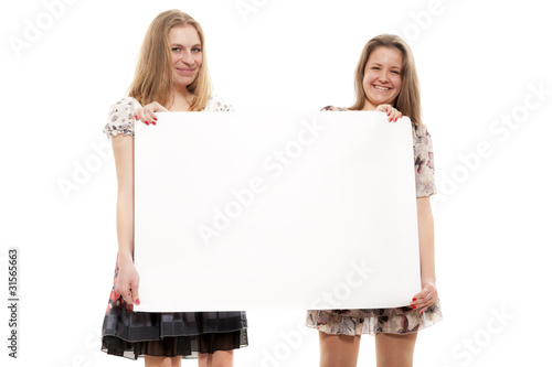 Two girls hold a paper blank leaf