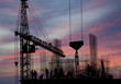 silhouettes of construction workers, construction equipment and