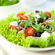 Delicious vegetable salad with feta cheese and olives