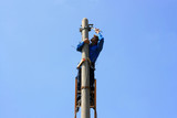 Electrician on the tower electric pole