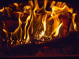 Fire blazing in the fireplace poster