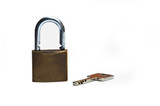 Old padlock isolated on white background