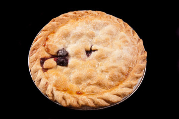 cherry pie on a black background