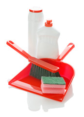 brush on dustpan with bottles and sponge