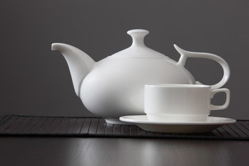 White teapot with a mug