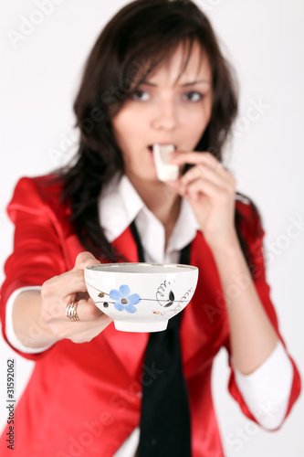 Beautiful brunette lady eating marshmallow sticks and sharing br