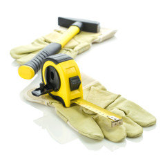 gloves with measuring tape and hammer