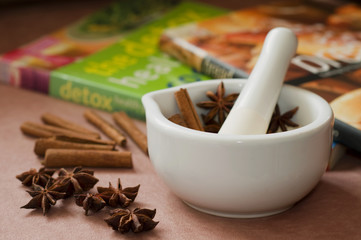 Star anise with cinnamon and mortar and pestle.