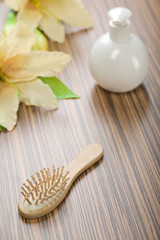 round bottle and hairbrush with flower