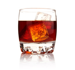 Glass of whiskey with ice cubes isolated