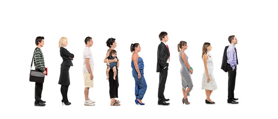Full length portrait of men and women standing together in a lin