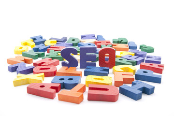 The word seo written with colorful wooden letters