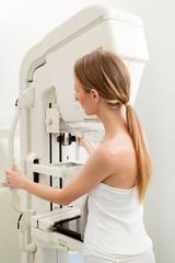 Woman Taking Mammogram