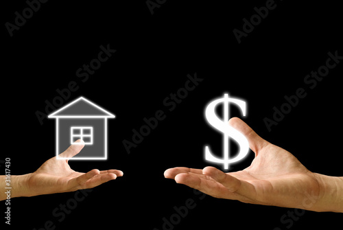 Small hand exchange house with Dollar icon from the big hand