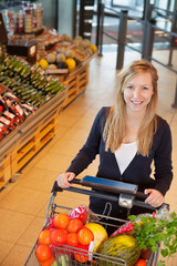 Portrait of woman holding shopping cart