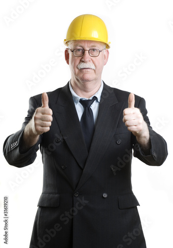 Business person with hardhat giving thumbs up