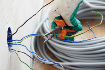 worker puts the wires