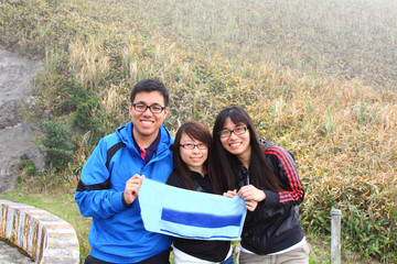 Chinese mountain hikers with big smile