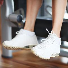 Beine am Fitnessgerät