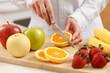 Woman cutting orange