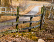 Wooden fence bending along the path