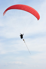Red paraglider on the rope