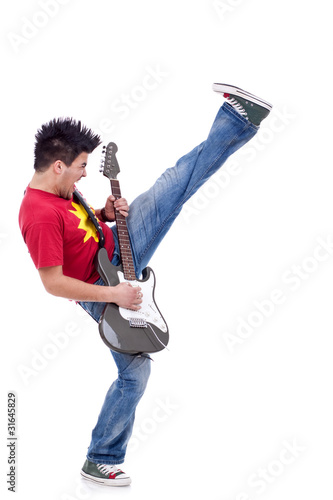 kicking guitarist playing