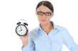 woman with an alarm clock in a hand.