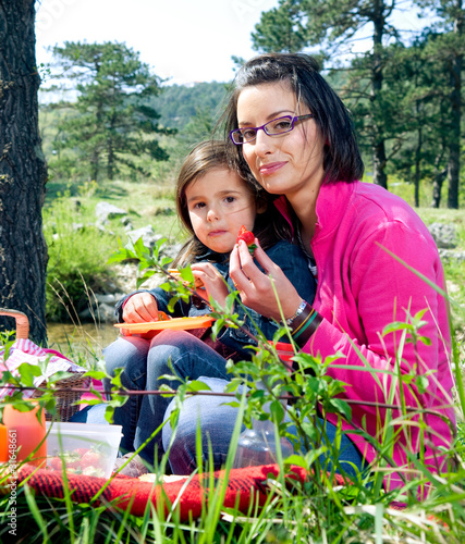 Mother and her daughter on a picnic