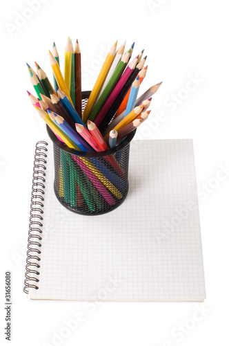 Set of pencils on a writing-book