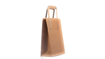Brown shopping bag turning on itself