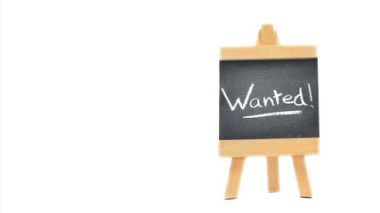 "Word ""Wanted"" written on a blackboard"