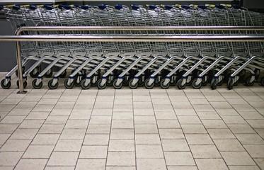 Empty shopping trolleys in a market