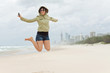 happy young woman jumps on the beach