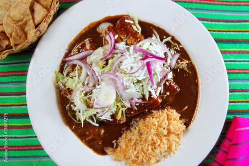 enchiladas de mole and rice Mexican food