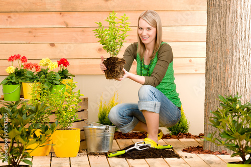 Gardening woman plant spring flower terrace