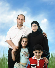 Muslim Arabic family of four members outdoor