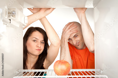 Couple looking in fridge