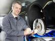 Master mechanic writing down repair and maintenance costs