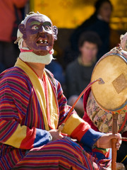 Bumthang, Bhutan - October 2010: A masked man making music durin