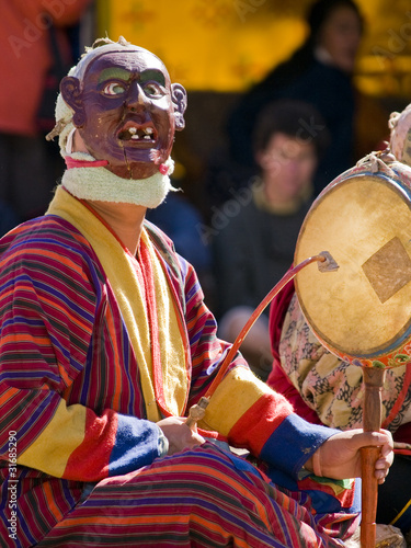 Bumthang, Bhutan - October 2010: A masked man making music durin