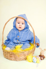 Funny child with easter eggs in basket